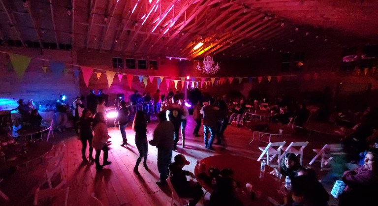 Locals-dance-to-the-high-energy-music-of-K-Iidad-Musical-at-Festival-Latino-de-Ocracoke-Saturday-at-the-Berkeley-Barn.