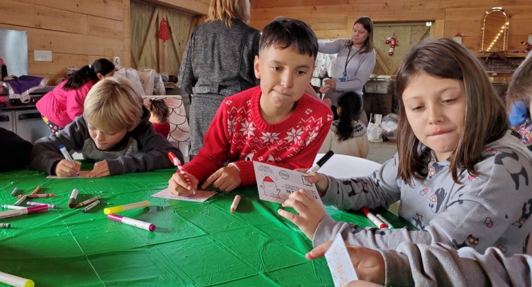 Ocracoke-third-graders-Javier-and-Sadye-write-letters-to-Santa-at-Berkeley-Barn-Friday