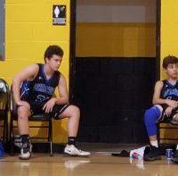 Dolphins-bench-with-Coach-Jason-Wells-on-right-in-Ocracoke-vs-Mattamuskeet-in-MS-BB-finals-at-Mattamuskeet-Feb-3-2020-e1581304167760